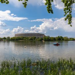 Enchanting Travels Germany Tours Panorama view of the Documentation Center and Congress Hall of the Nazi Party Rally Grounds in Nuremberg, with the Dutzendteich lake in the foreground, Bavaria, Germany - German History