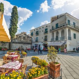 History of Italy - Duomo square under a cloudy sky in world famous Ravello, Amalfi coast.