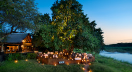 Outdoor dinner area at Lion Sands Tinga Lodge Hotel, South Kruger in South Africa