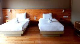 Twin room at Lobesa Hotel in Punakha, Bhutan