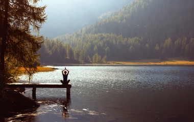 Meditation and yoga practicing at sunset