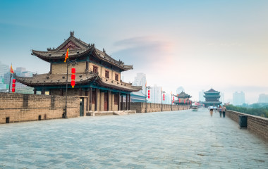 Enchanting Travels China Tours beautiful xian city wall and ancient tower at dusk, China