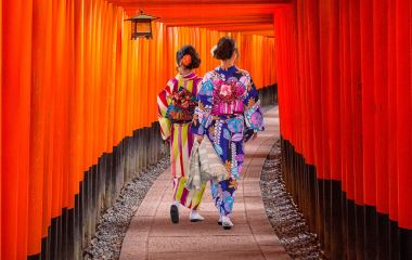 Top 10 temples in Japan - Women in traditional japanese kimonos walking at Fushimi Inari Shrine in Kyoto, Japan