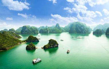 Enchanting Travels - Asia Tours-HALONG bay in vietnam. UNESCO World Heritage Site. This view from TiTop island and its most popular view for travel in Halong bay.