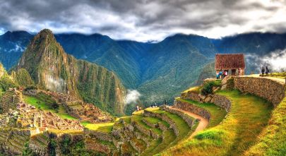 Enchanting Travels Peru Tours - Panoramic HDR image of Machu Picchu, the lost city of the Incas on a cloudy day. Machu Picchu is one of the new 7 Wonder of the Word near Cusco