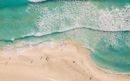 Enchanting Travels Mexico Tours Top view of beautiful beach - Best trips to take in 2020