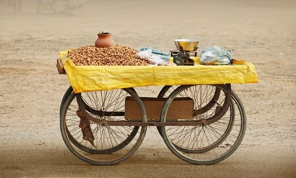 movable-counter-to-sell-roasted-peanuts-india-rajasthan-india-asia-shutterstock_123743368