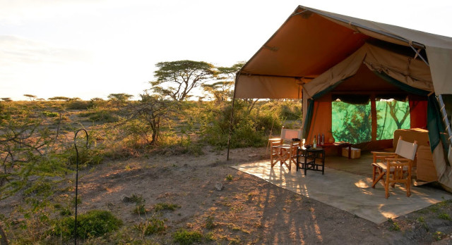 Outdoor area of a guest tent at Ubuntu Camp S Hotel in Serengeti (Southern), Tanzania
