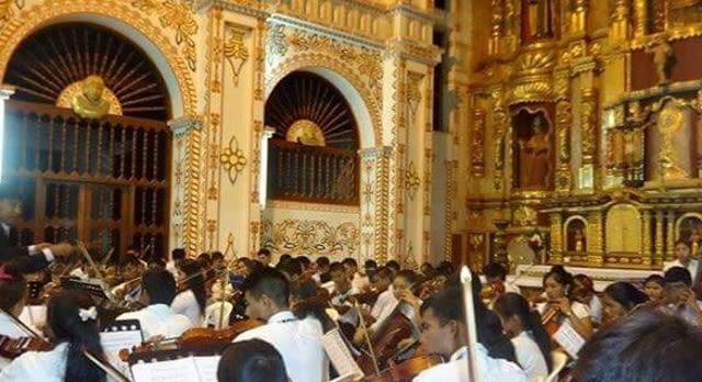 The choir performing inside the church