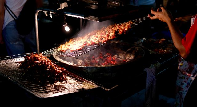 Southeast Asian street food: Grilled meat at a night market in Vietnam