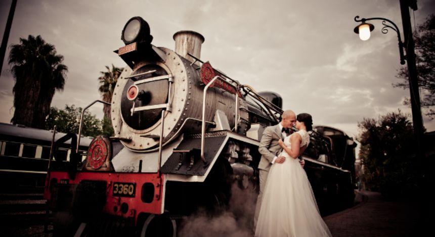 Bridal couple in front of a train