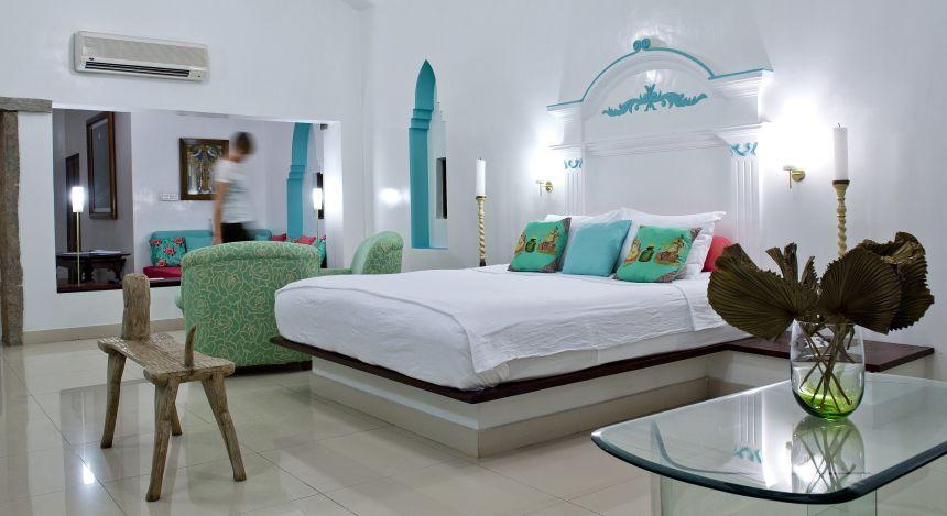 Ein Bett im Schlafzimmer vom Purity Resort Hotel in Kerala, Indien