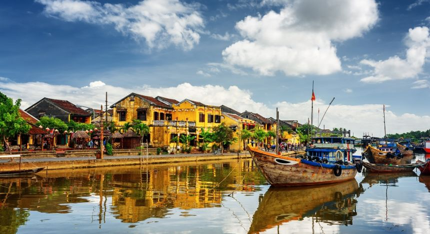 Enchanting Travels Vietnam Tours Hoi An Wooden boats on the Thu Bon River in Hoi An Ancient Town (Hoian), Vietnam.
