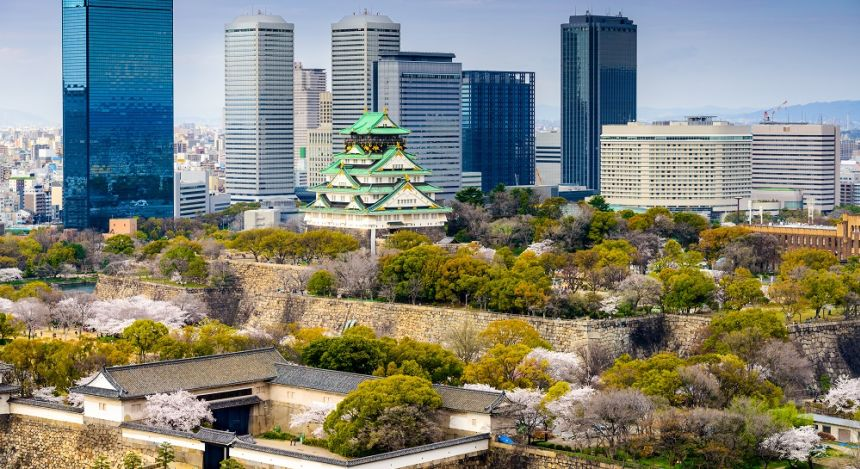 Enchanting Travels Japan Tours Osaka Japan city skyline at the castle and business park in the spring.
