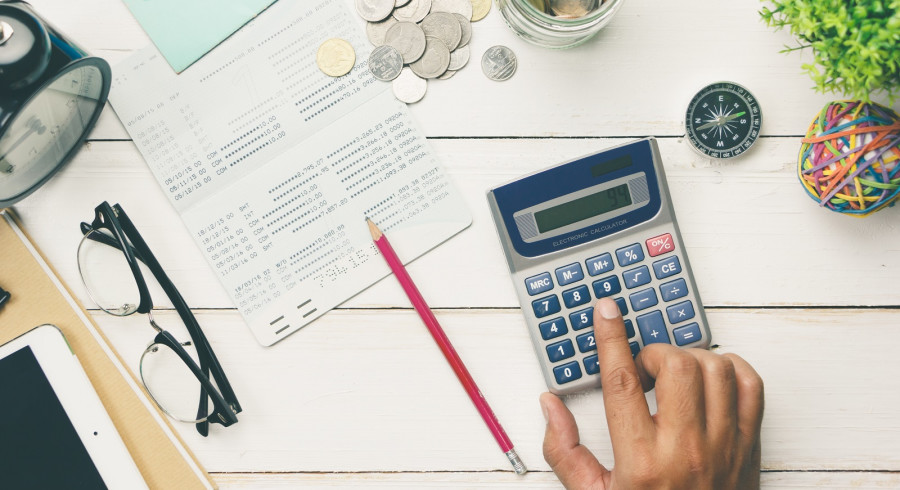 Accountant verify the Saving Account Book and Statement of financial statements