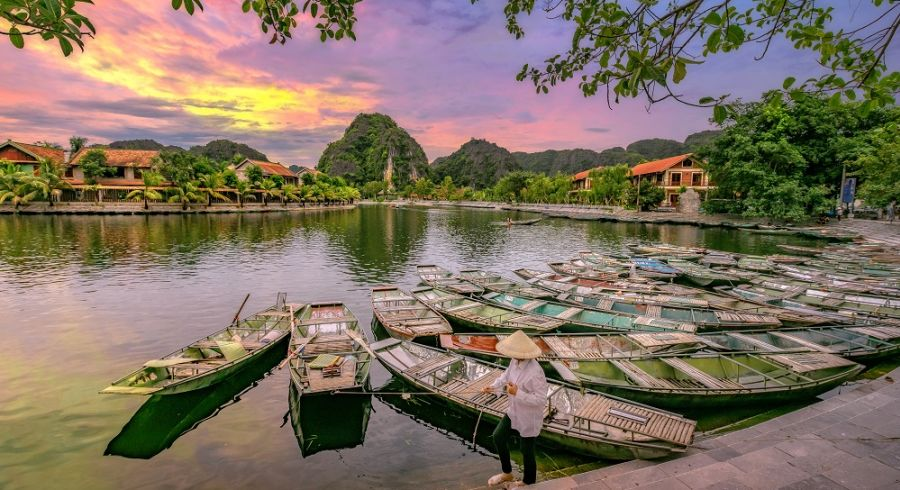 Enchanting Travels Vietnam Tours Hoi An Rowing boat Waiting for passengers at sunrise,