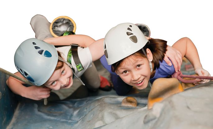 Junior_male_and_female_climbing_wall.jpg