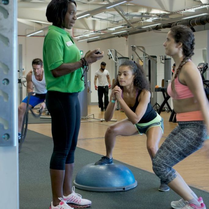 Two women and instructor in let's target fitness class