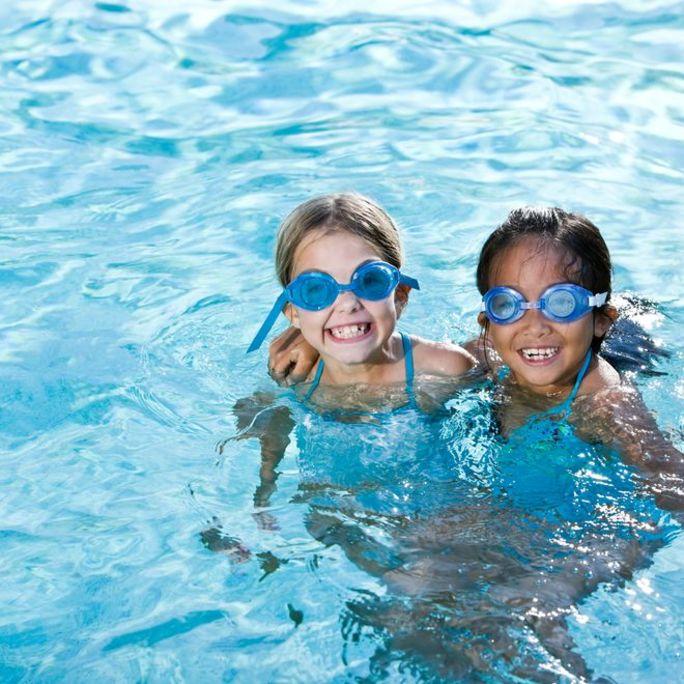 Girls playing in swimming pool.