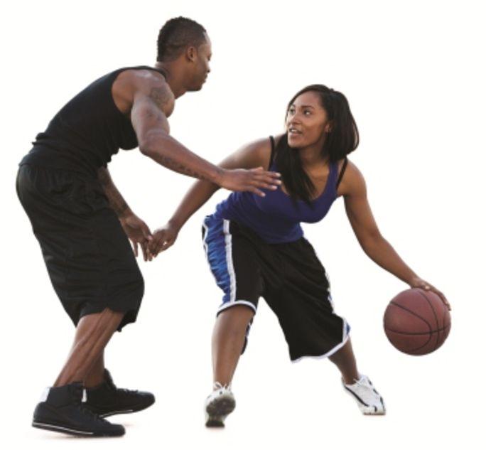Man and woman playing basketball