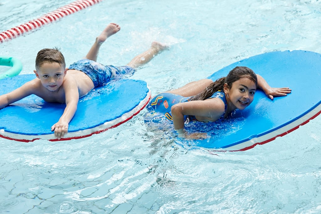 Children enjoying a BETTER swimming pool party