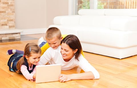 Banner mobile family looking at home portal on laptop