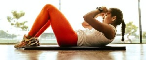 300x125resizewoman wearing orange leggings and white tank top doing pull 3076513