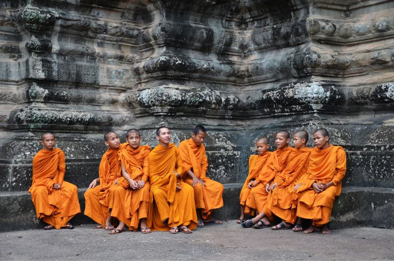 Monks in Orange Robes at Angkor Wat