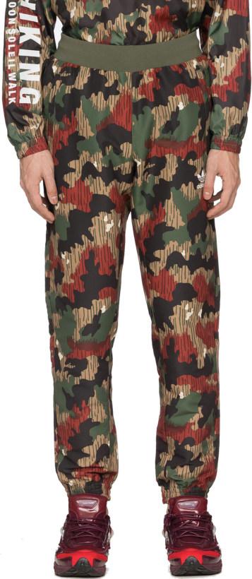 2850423ce9a adidas Originals. Pharrell Williams Hu Hiking Camo Windbreaker Pant - Multi  Camo