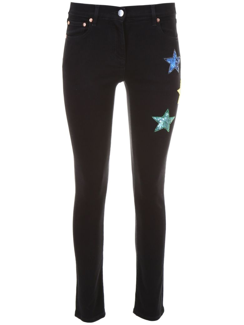 JEANS WITH STAR PATCHES