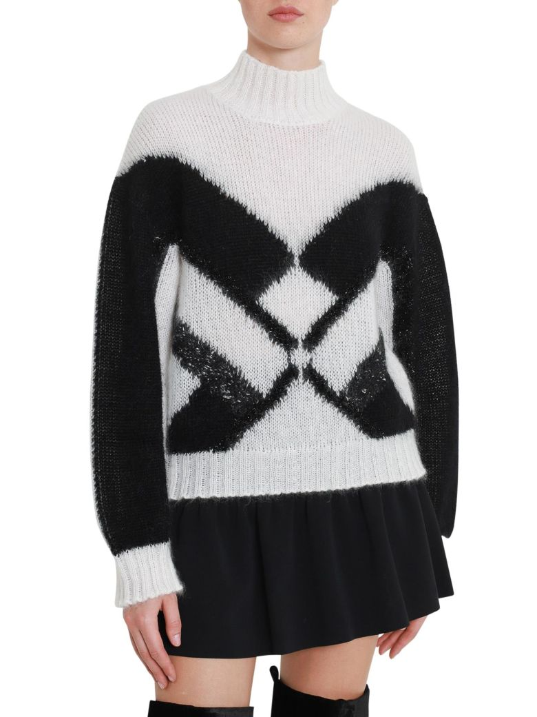 geometric intarsia polo neck