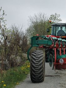 Kverneland BE transported on road by tractor
