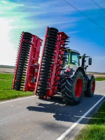 Kverneland F35 compact travelling on road with tractor
