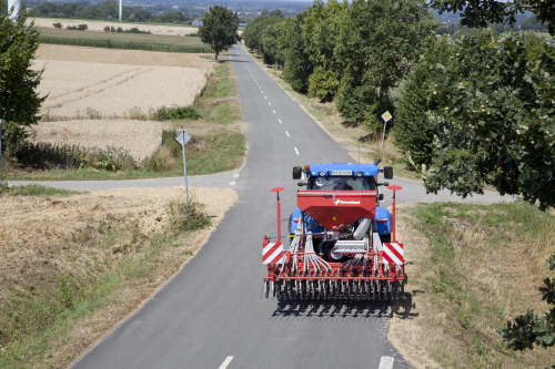 Kverneland S-Drill transported on road by tractor