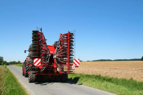 Kverneland U-drill, transported on road by tractor
