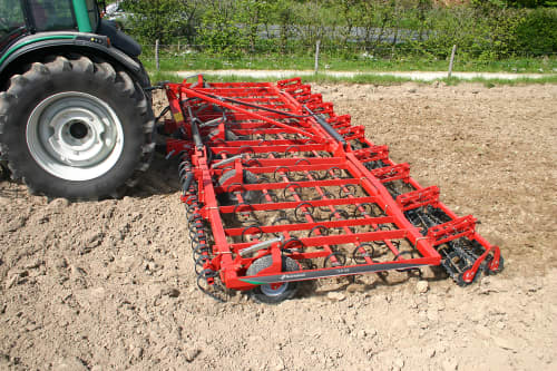 Seedbed Cultivators - Kverneland TLF performs precise depth control during operation on field