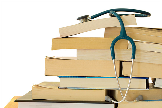 Stethoscope on top of books