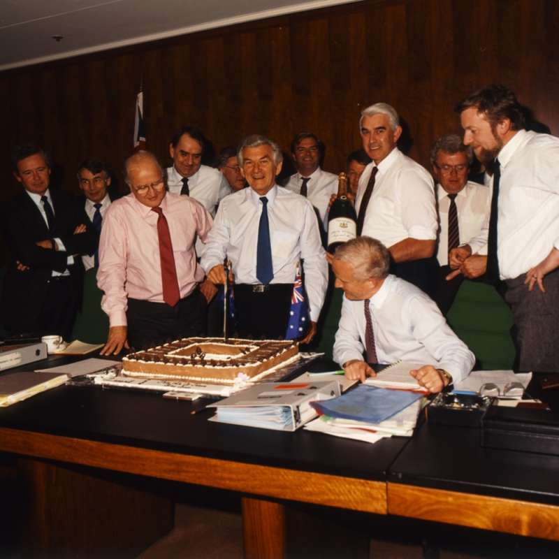 Prime Minister Bob Hawke cuts the cake at the last meeting of the Cabinet in Old Parliament House. National Archives of Australia.