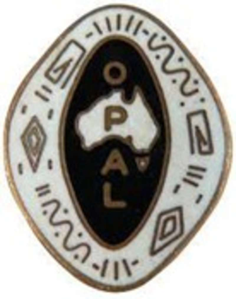 An oval-shaped badge with black, white and gold details and a map of Australia in the centre. Text on the badge reads O.P.A.L.