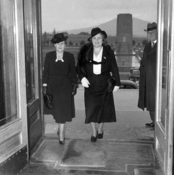 Australia's first female federal politicians, Senator Dorothy M Tangney (left) and Dame Enid Lyons GBE, entering the front door of the House of Representatives. 1943. Australian War Memorial.