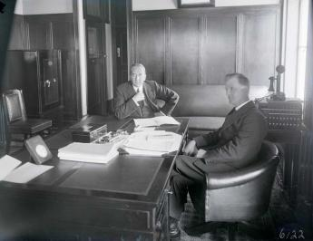 Prime Minister Stanley Bruce and James Scullin in Old Parliament House, the day before Scullin was sworn in as the new Australian prime minister.