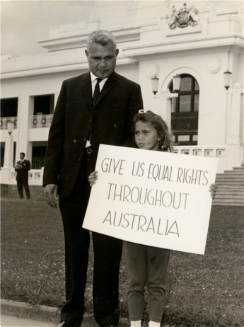 Former boxer Jack Hassen and his daughter demonstrating outside Parliament House, Canberra, in the lead up to the 1967 Referendum. AIATSIS Collection