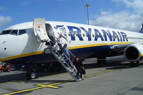ryanair passengers get on the plane