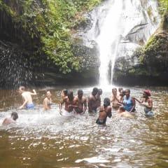 swimming under African waterfalls