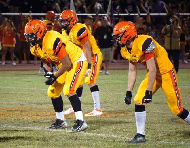The Corona del Sol defense gets into position during a home game against Westview earlier this year.  The Aztecs have made the playoffs for the first time since 2015.  The last time Corona was in the largest-class playoff bracket was in 2008.  The Aztecs travel to East Mesa to face Red Mountain this Friday.  (Photo by Ralph Amsden)