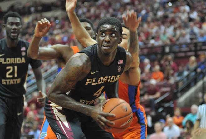 Sophomore Dwayne Bacon works to make a play inside the UF defense on Sunday.