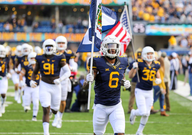 Grier throws for four touchdowns in West Virginia's win over K