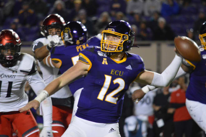 ECU quarterback Holton Ahlers set the all-time ECU and AAC records with 535 yards passing against Cincinnati.