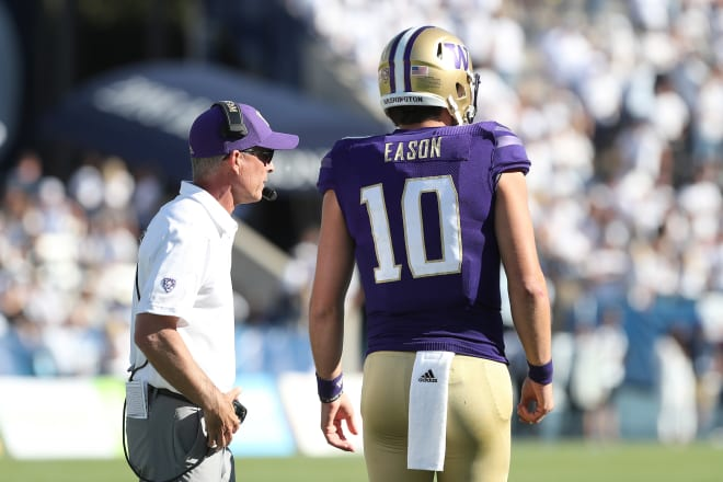 Washington Huskies head coach Chris Petersen and quarterback Jacob Eason (10) talk on the field during the fourth quarter against the BYU Cougars at LaVell Edwards Stadium. Photo Credit: Melissa Majchrzak-USA TODAY Sports