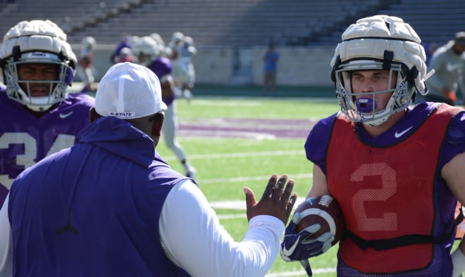 Harry Trotter looks to running backs coach Brian Anderson for instruction.
